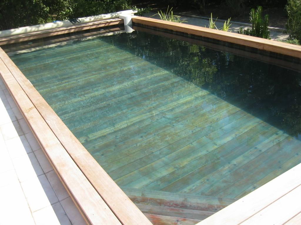 Maison bois avec piscine deco petit jardin avec piscine for Chauffe piscine bois